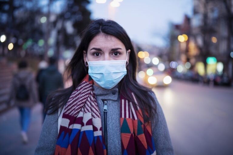 Woman with disposable medical mask