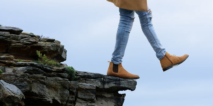 Woman standing on cliff edge